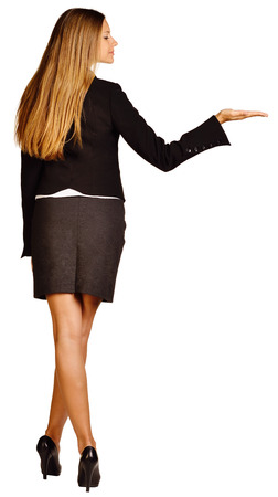 Business woman holds in her hand raised and looks at it photo