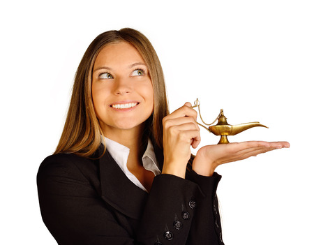Business woman holding a lamp of Aladdin Stock Photo