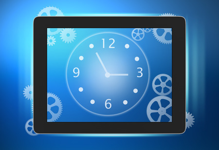 tablet with a clock and gears on the screen Stock Photo