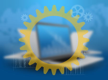 blurred background notebook and a large gear