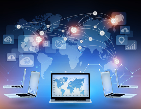 wireles: Laptops and world map with connection points in the network Stock Photo