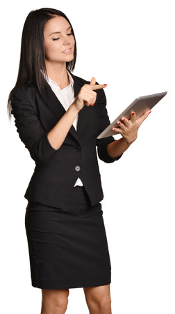 Business woman holds in hands mobile tablet Stock Photo