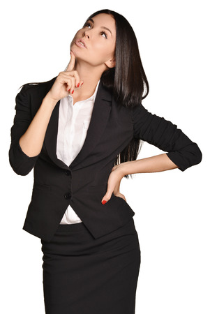 forefinger: Business woman looking up forefinger pressed on the chin