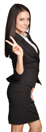 skirt suit: Business woman in a suit and skirt showing finger victory