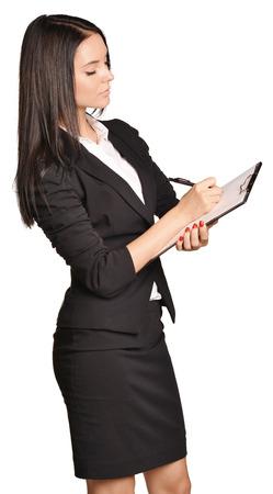Beautiful girl writes a pen holder paper Stock Photo