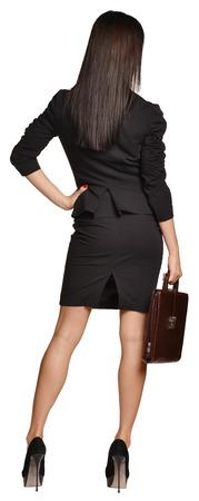 faldas: Mujer de negocios que sostiene en su malet�n de mano de cuero Foto de archivo