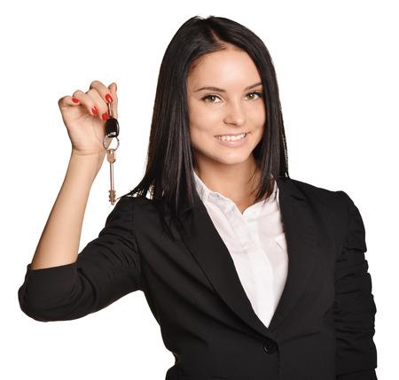 Beautiful girl broker holding sale house key. white background