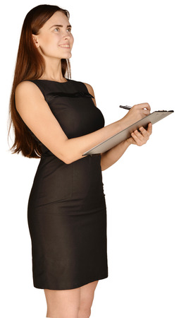 Business woman holding a pen and clipboard Stock Photo