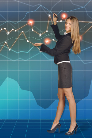 Business woman standing and draws felt pen drawing shows his hand. photo
