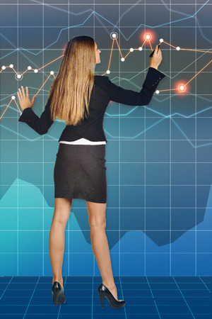 Business woman standing and draws felt pen drawing. photo