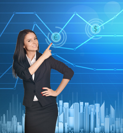 Business woman showing index finger on icon of euro. photo