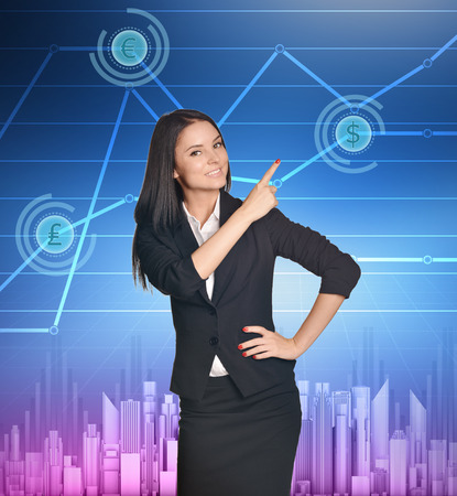 Business woman showing index finger on icon of dollar. photo