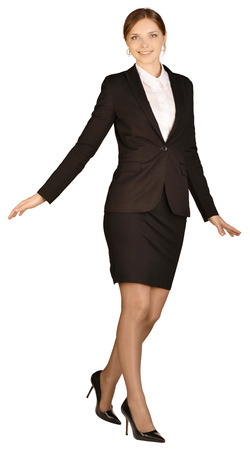 looking ahead: Business woman standing on one leg and looking ahead.