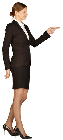 forefinger: Business woman shows forefinger forward. white background. Stock Photo