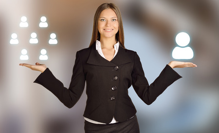 recruitment: The girl from Recruitment weighs on hands of staff. Stock Photo