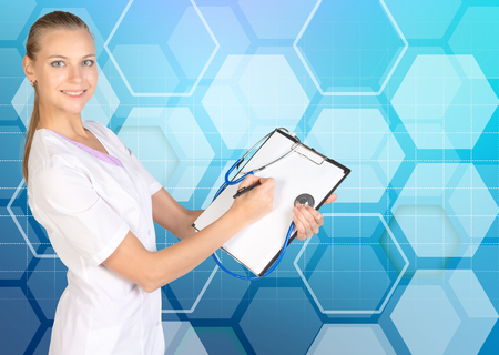 prescript: Clip board. Stethoscope. The doctor fills out a medical form. Honecomb blue background