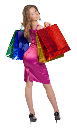 female shopper: Young girl standing with her back holding shopping bags. Stock Photo