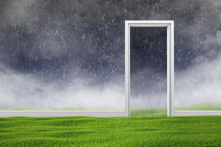 natural backgrounds: Doorway in bad weather with rain. The green lawn in the foreground. Stock Photo