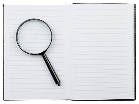 blank book cover: Open notebook with a magnifying glass. isolated.