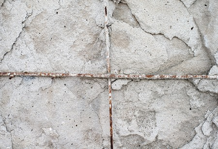 Texture cement wall of destroyed construction with fittings. Stock Photo