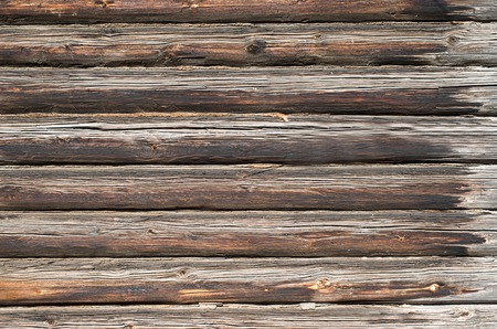 Background texture wall of wooden logs. Weathered pine planks