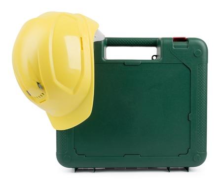 yellow helmet: Closed tool box with construction yellow helmet.