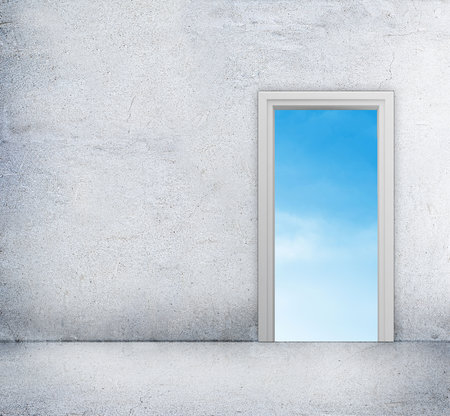 room access: Concrete room with access to blue sky through the doorway. Stock Photo