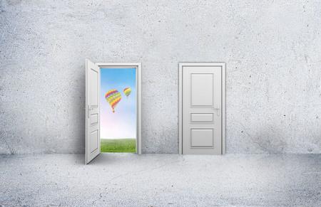 room door: Open door with a view of the sky and hot air balloons. Concrete room.