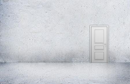 room door: Concrete room with empty wall and wooden door.