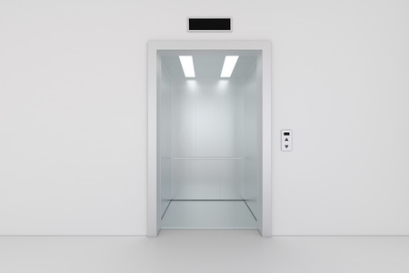 Open chrome metal office building elevator doors.
