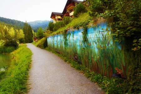 paddock: view on a lake side with wild nature scenery wall painting.