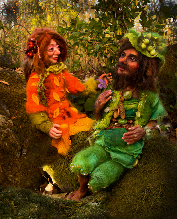 faerie: two fairy tale dwarf figures sitting on moos in woodland. Stock Photo