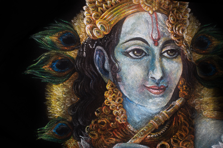head of krishna with peacock feather and jewelry, hand painted.