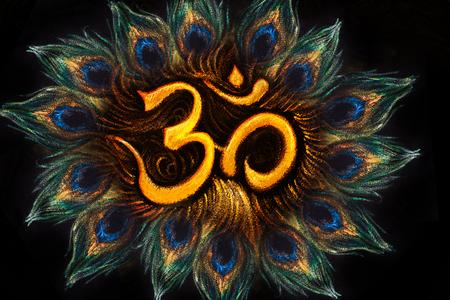 sanskrit: sacred aum sanskrit symbol in circle of peacock feathers.