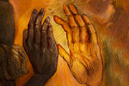 special moments: two hands from two different worlds comming together in love promise, painting. Stock Photo