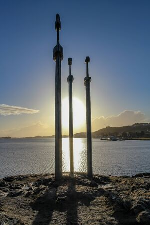 Three iron swords in a rock, sverd i fjell during sunset, Stavanger, Norway Banco de Imagens