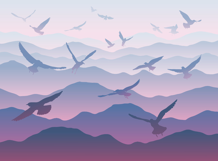 mountain pass: silhouettes of flying birds over mountains