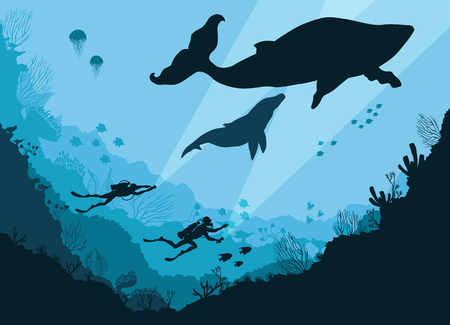 Silhouettes of divers underwater Stock Photo