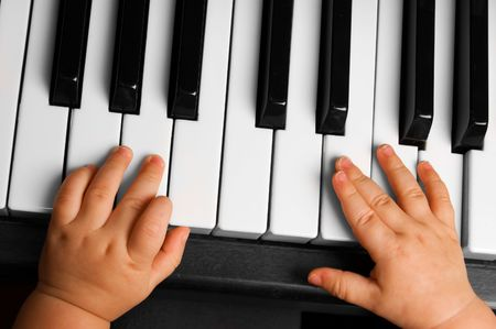 Baby going to play the piano