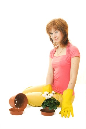 replanting: Young woman are going to replanting a flower