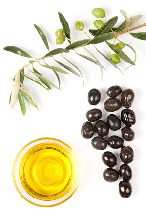 Branch of fresh green olives, black olives and olive oil on white 写真素材