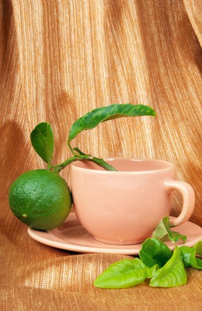 A cup of bergamot tea, bergamot orange fruit and fresh bergamot leaves  Stock Photo