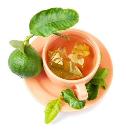 A cup of bergamot tea, bergamot fruit and fresh bergamot tree leaves
