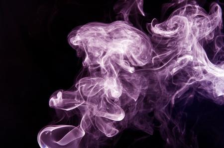 Violet curved smoke on black background 写真素材