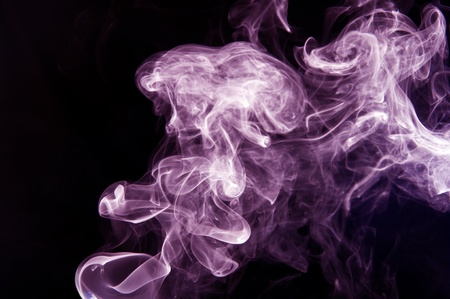 Violet curved smoke on black background photo