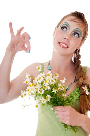 maquillaje de fantasia: Mujer hermosa con maquillaje de fantas�a celebraci�n chamomiles Foto de archivo