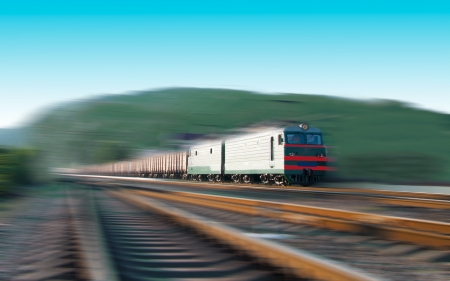 Fast freight train with motion blur