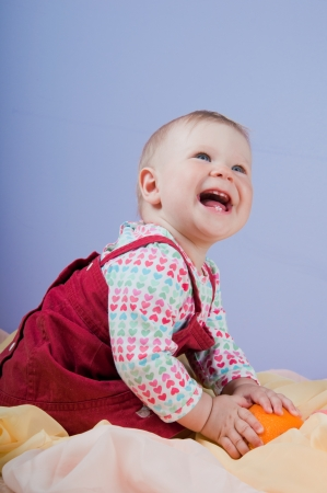 Adorable 10 month baby-girl smiling photo