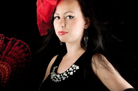 Beautiful elegant woman with fan in black evening dress photo