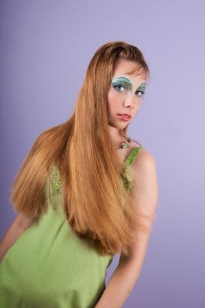 fantasy makeup: Beautiful young woman with blue fantasy makeup